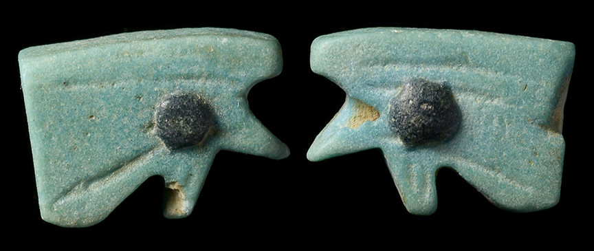 small faience eye of horus amulet light blue color with incised decoration and raised black faience details on both sides - Faience Colore