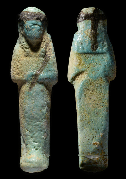faience ushabti depicted mummiform wearing a tripartite wig and false beard arms folded across chest hands holding a pick and hoe light blue color - Faience Colore